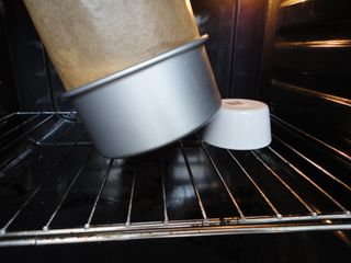 How to bake a topsy turvy cake. Prop up something under the pan so it bakes on an angle