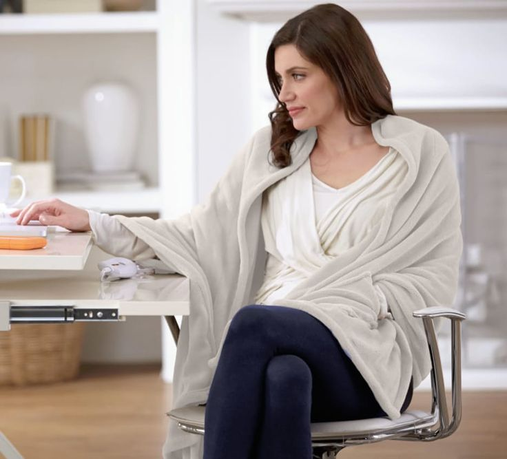 Heated Electric Cuddler Throw with Warming Pockets and Four Heat Settings by Serta at Overstock, $54.99Perfect for your desk, this blanket is warm like a shawl and, wait for it...it has warming pockets for your hands!