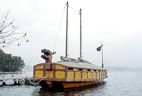 """THE KOBUKSON, or """"Turtle Ship"""" may be the world's first recorded ironclad warship type-- used by the Royal Korean Navy during the Joseon Dynasty from the early 15th century up until the 19th century.  Turtle Ships were enclosed on all sides and primarily rowed, though they had two masts.  Iron plates with spikes were bolted on the roof to prevent bording, and cannons fired in all directions.  Used primarily against Japanese invaders, the Kobuksons were particularly effective vs. wooden…"""