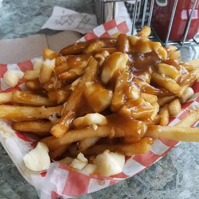 Our first #poutine and it was flipping delicious #beacondrivein