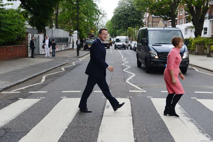 David Cameron and Labour's former culture secretary Tessa Jowell try to recreate the famous Beatles album cover during a visit to Abbey Road studios to meet representatives of the creative industries