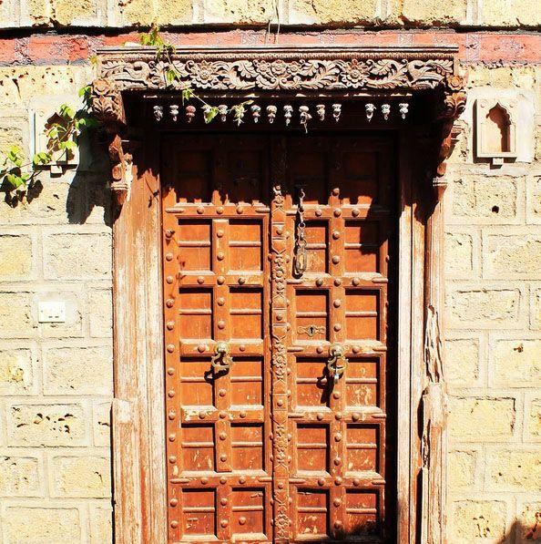 Kutch, Gujarat, India Create trip plan to Kutch with  www.TripJinnee.com #kutch #rannutsav #village #woodendoor #wooden #Architecture #door #gate #old #gujarat #gujarattourism #khusbugujaratki #religious #traveltoindia #incredibleindia #triptoindia #tripplanner #india #beautiful #amazing