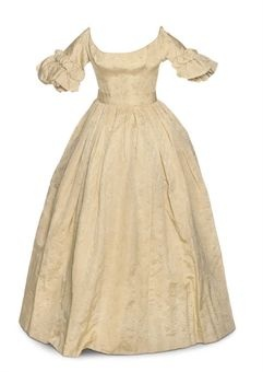 Afternoon gown of tawny figured silk; late 1830's. fitted bodice and sleeves that flare at the elbow