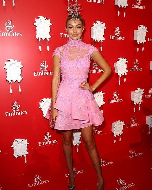 #GIGIHADDAD This international model has really nailed it in Barbie pink #AlexPerry, but it's her star-filled headpiece that brings the outfit home. Ladies please note: this is the exact ratio of delicate to pretty to sexy to ladylike that you need in a #MelbourneCup outfit. She looks comfortably gorgeous.