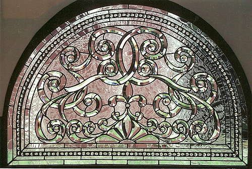 Beveled Glass Arch Window  Arch curlicue window with hand-beveled pencil point bevels and jeweled border.  Sunflower Glass Company