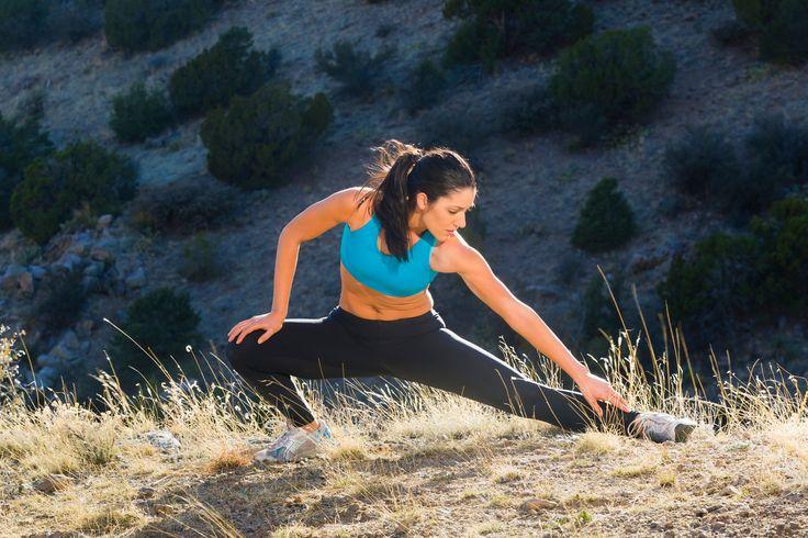 Hispanic woman stretching before exercise - Hispanic woman stretching before exercise