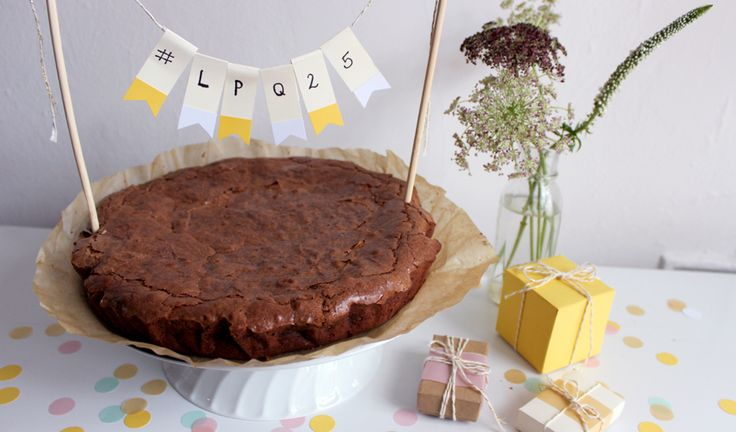 It's our birthday and we'll bake our own cake if we want to! We're celebrating our 25th year with this recipe from the Le Pain Quotidien Cookbook - a decadent spin on the traditional chocolate birthday cake. Crispy on top like a brownie and wonderfully soft and moist on the inside, like chocolate mousse, this is an easy-to-make dessert that deserves a place in your repertoire. Get out your mixing bowl and party hat and celebrate with us!