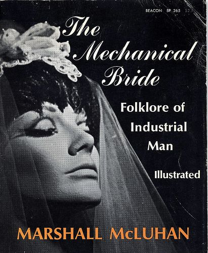 """THE MECHANICAL BRIDE -  McLuhan's look at American society thru its popular media culture in the early 1950s at the nadir of print technology and the dawn of the age of electronic media, from radio to TV and the Internet. The linear visual """"folklore"""" of industrial society on the verge of a profound transformation maybe hinted at in the non-linear presentation of the newspaper front page and its comic section. http://www.leftyparent.com/blog/2009/05/23/the-mechanical-bride/"""