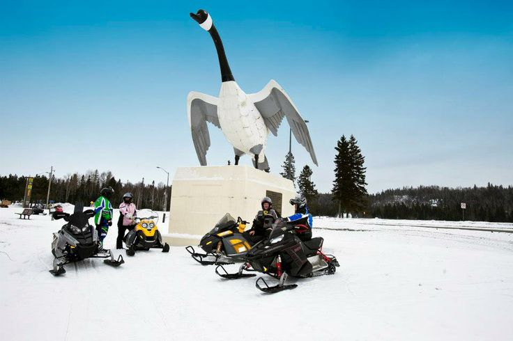 Snowmobiling in Wawa for a photo op with the famous Wawa Goose Monument. - Algoma Country