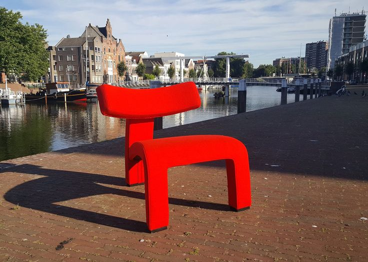 """The iconic The Red Devil has been designed by Danish Furniture architect Carsten Buhl and is being produced by Skipper Furniture. The inspiration from """"The Space Journey of year 2001"""" (original title 2001: A Space Odyssey) - directed by Stanley Kubrick 1968 – is obvious.  The Red Devil is a piece of graphic furniture rousing the fantasy. On these pictures the chair is on display in beautiful surroundings in Rotterdam, Holland.  The fine images are courtesy of our partner in the Netherlands,"""