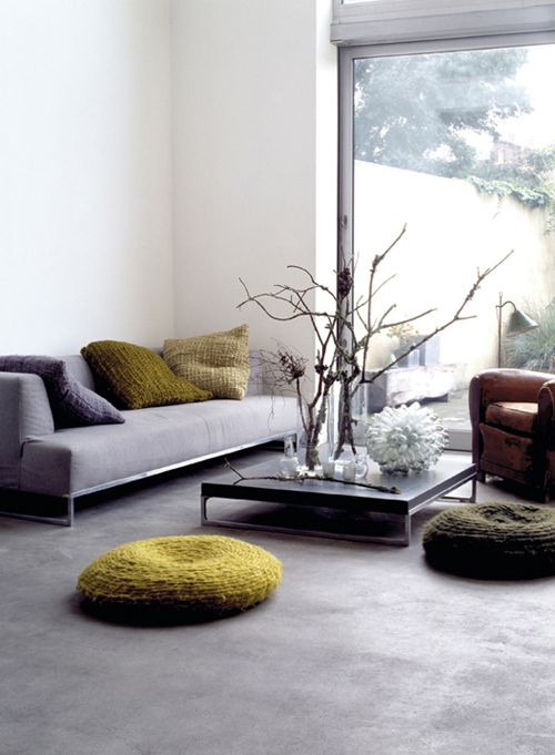 I like the idea of having floor pillows in the living room. I love sitting on the floor! (it is harder to slouch too.)