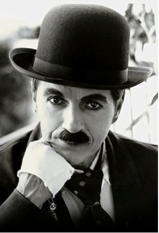 Charlie Chaplin - Making the Bowler Hat a life long trend that will always be associated to him.