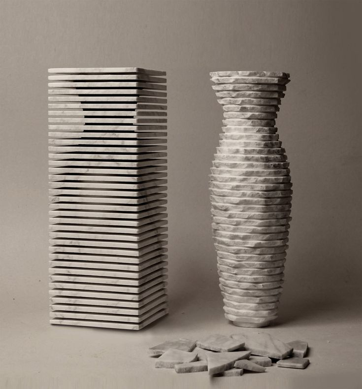 paolo ulian and moreno ratti have crafted a marble vase called 'introverso 2′. the defining feature of the form is its bipolar personality. this duality is articulated through the suggestion of two surfaces. the first is negotiated by a series of stacked contours with horizontal interstitial spaces that create a rhythmic pattern of solid and void. the combination presents the work as a rectangular prism of metamorphic rock.