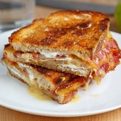 Brie, goat cheese, bacon, and green tomato. Sweet mother of grilled cheeses...