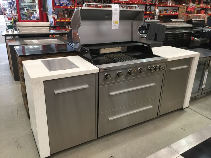 Outdoors: BBQ kitchen with wok burner on one end & mini bar fridge at the other ... At Bunnings
