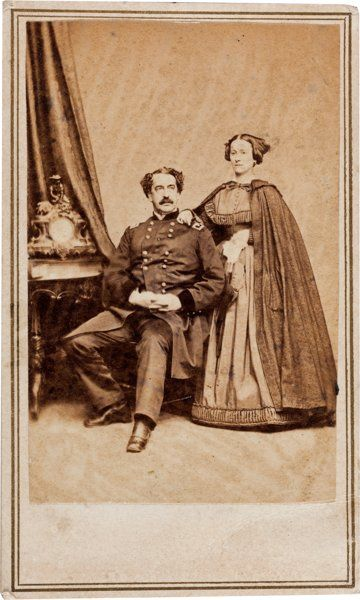 """General Abner Doubleday and Wife Carte de Visite. 2.5"""" x 4"""". The general is seen sitting, in uniform, with his wife, Mary, standing behi..."""