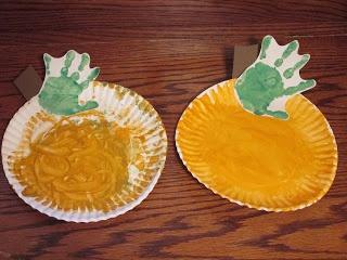 Hand print paper plate pumpkin craft for kids