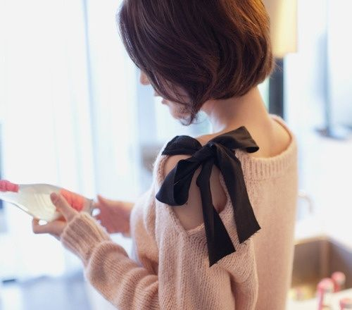 "Sweater Embellishments: Take an old sweater. Cut a slit in along the shoulder down about 7"". Fold over raw edge and sew in place. Sew a piece of ribbon about 15"" long to one side of neckline and another ribbon to the other side of the neckline. Tie together!"