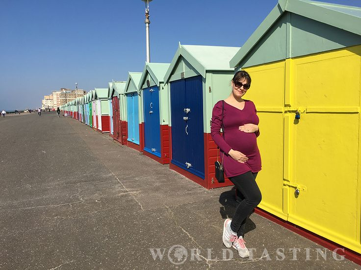 Adorable colorful beach huts along the Hove shoreline. British summer at its best.