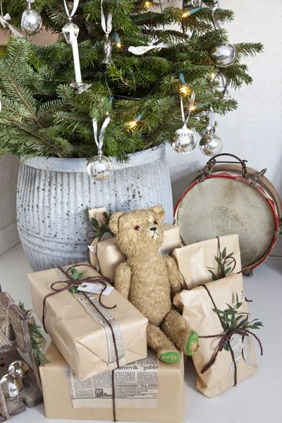 I did this one Christmas wrapped the presents in brown paper twine for an old fashion Christmas   Tree was done in all natural ornament I made It was Beautiful!!!