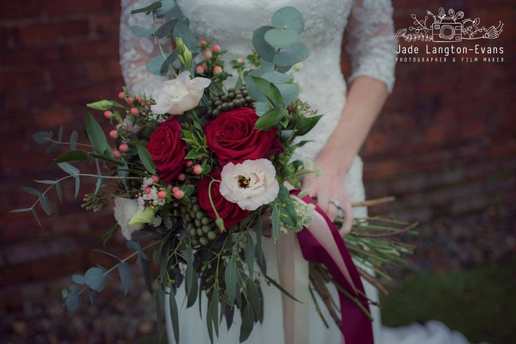 Florissimo, Shropshire - Flowers for weddings, events and businesses | Bohemian-chic large hand-tied bridal bouquet of red roses, blush pink lisianthus, white astrantia, red hypericum berries, brunia berries, japonica blossom, eucalyptus and seeded eucalyptus. Styled winter wedding photoshoot, The Townhouse, Oswestry