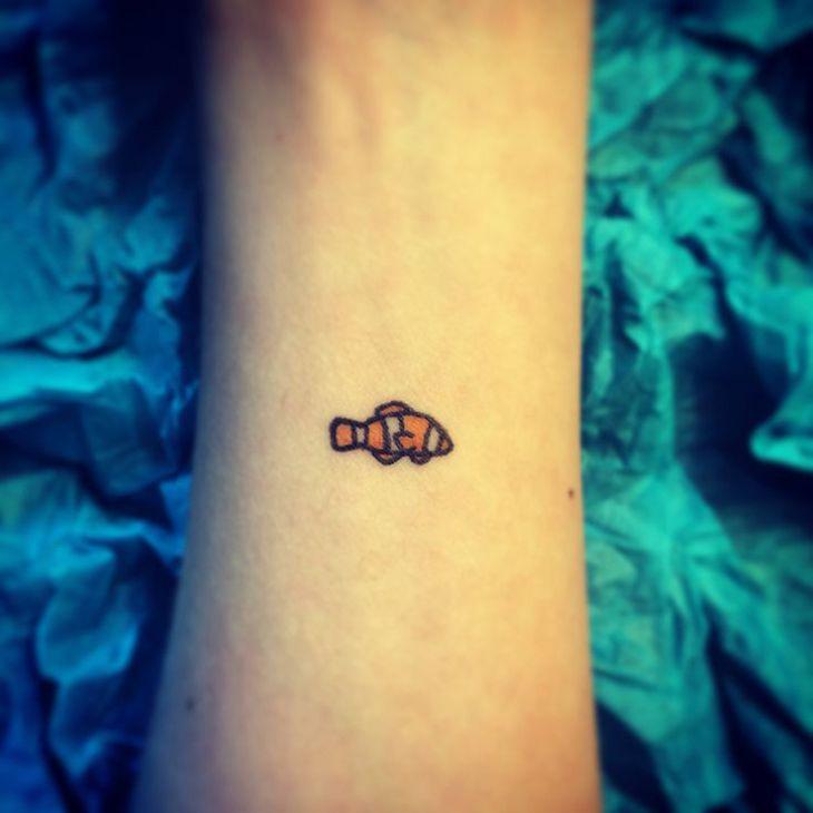 Best 20 small fish tattoos ideas on pinterest fish for Small koi fish tattoo