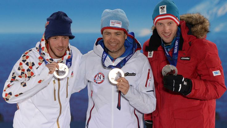 Medalists Jaroslav Soukup (bronze) of the Czech Republic, Ole Einar Bjoerndalen (gold) of Norway, and Dominik Landertinger (silver) of Austria pose for a group picture upon receiving their respective medals for the biathlon men's 10km sprint on Day 2.