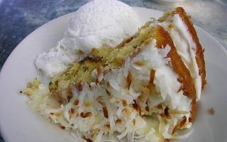 Famous coconut cake at Peninsula Grill At Planters Inn