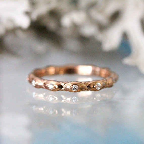 This rose gold leaf and diamond eternity ring: