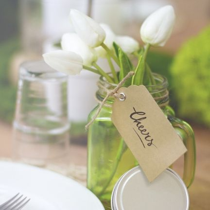 Mason jars as table centrepieces are gorgeous and trendy.