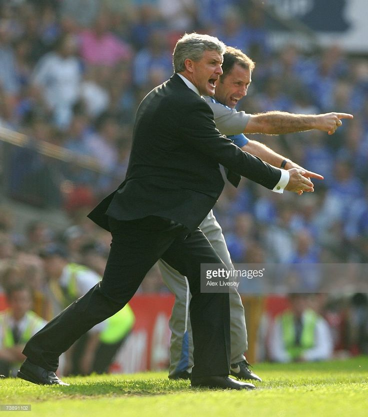 Blackburn Rovers Manager Mark Hughes (L) shouts instructions to his players during the FA Cup sponsored by E.ON Semi Final match between Blackburn Rovers and Chelsea at Old Trafford on April 15, 2007 in Manchester, England.