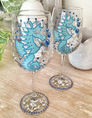 Set of two hand painted wine glasses. Great hostess gift.