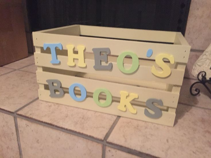 Book crate for Baby Shower. Instead of greeting cards we asked guests to bring a favorite children's book to start Theo's book library~