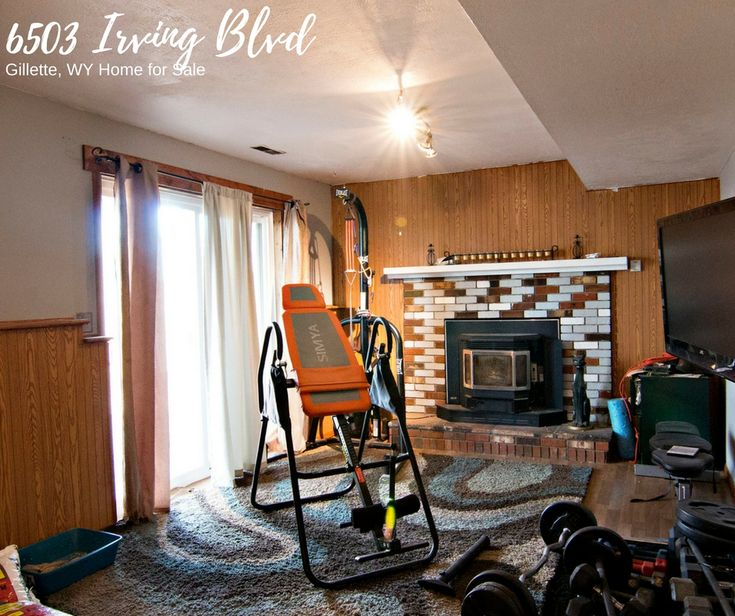 6503 Irving Blvd in Gillette, WY offers two living areas - this lower one boasts a tile accented fireplace.
