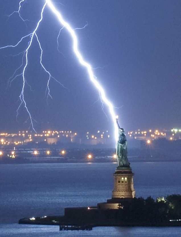 This is the moment the Statue of Liberty was hit by lightning - and caught on camera by a photographer who waited two hours in a storm-hit New York City.