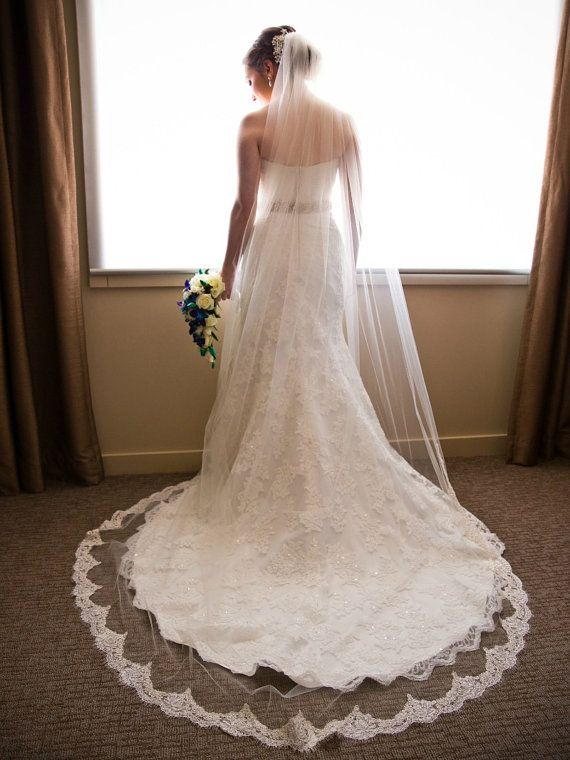 Put the finishing touch on your wedding finery with this romantic and elegant cathedral veil in white, off-white or ivory! This veil is sewn