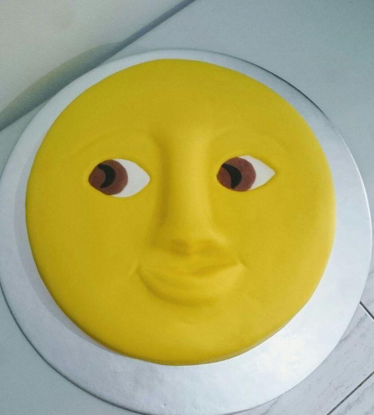 Moon face emoji Chocolate cake layers with hazelnut frosting