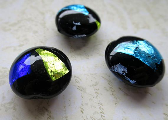 Venetian glass beads black glass with colored foil lentil