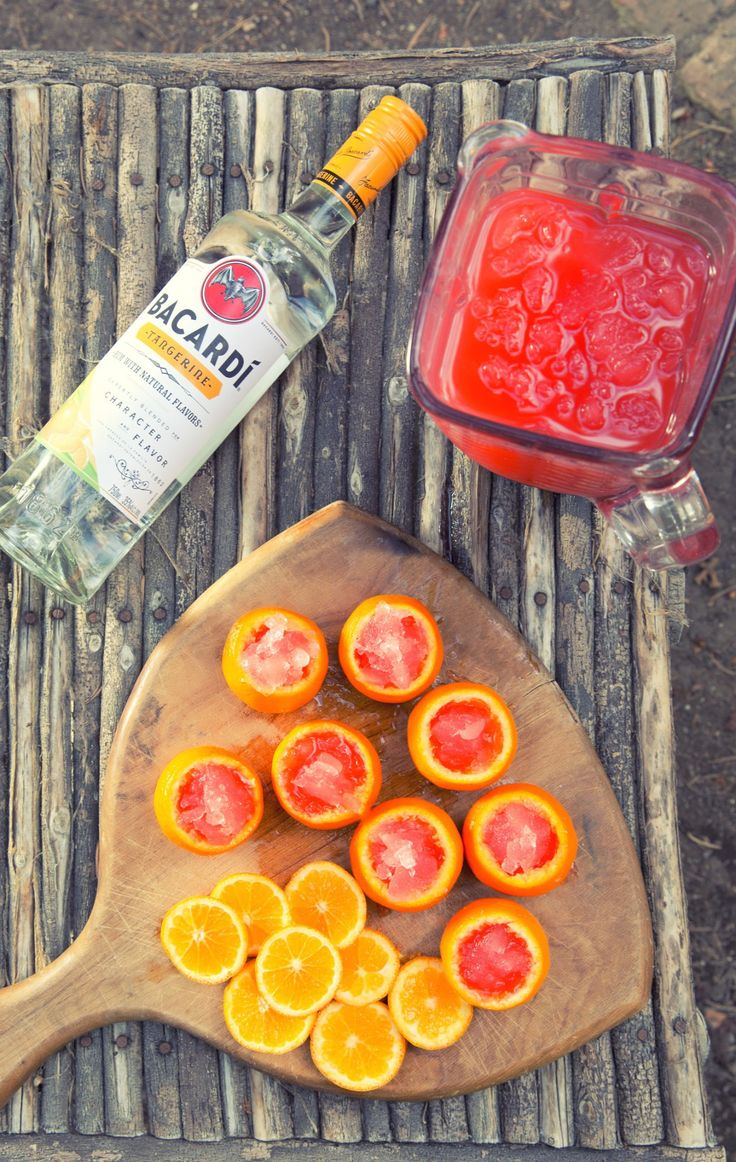Mix up a few shots of Bacardí with your favorite fruit juice. I use strawberry lemonade and then pour the mixture into these hollowed out oranges. So delicious! (sp)