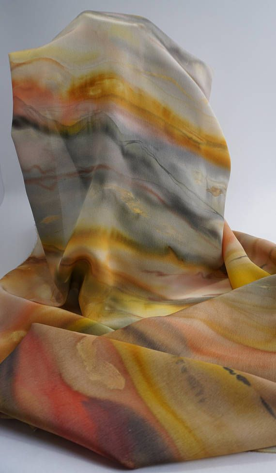 Novelty Hand painted silk crepe shawl Sand and gold 180 x 45 cm Unique and original creation The silk Crepe is a thicker and heavier silk to the silky touch Gold and sand dunes The warm breeze Sahara Lunar landscape Changing reflections Palette of yellow, ochre, Brown, sand Dream