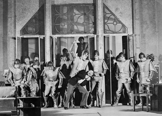 Scene from a 1928 performance of Karel Čapek's 1920 science fiction R.U.R.. The acronym stands for Rossumovi Univerzální Roboti (Rossum's Universal Robots)