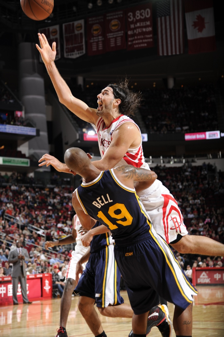 Luis Scola with the acrobatic shot.    For the latest Houston Rockets news & updates, visit www.rockets.com.