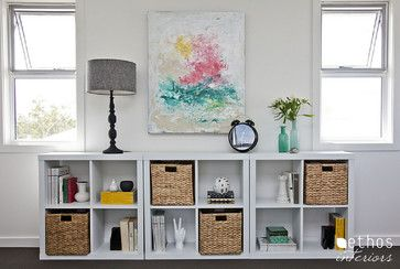 Ethos Interiors - Idea to replace our obnoxious file cabinet -stash small file boxes in pretty baskets and simple IKEA shelving below family room window -decorative and practical