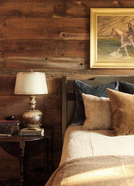 Simple wooded bed in log bedroom    Moose Creek Lodge Bedroom