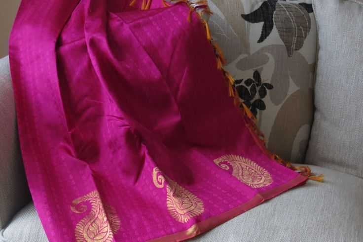 KANCHIPURAM SILK Border and Pallu : Zari Body Colour : Pink Border Colour : Golden Blouse Colour : Pinkish Orange Blouse : With Blouse Border : Double Side Good for any wedding wear.