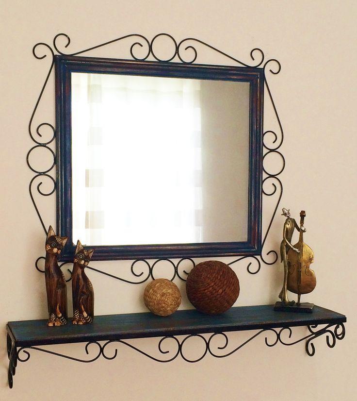 Conjunto de Moldura para espelho + aparador. <br>Produzido artesanalmente, com ferro e madeira. <br> <br>Aparador - 0,80 m x 0,25 cm (profundidade) <br>Base em ferro, fixada por parafusos. <br>Moldura - 0,60 x 0,60 cm (medida total) <br>Largura da moldura (ornatos e madeira) 15 cm <br>A pintura das madeiras é feita em pátina, estilo madeira de demolição. <br> <br>* ESPELHO NÃO INCLUSO, SOMENTE A MOLDURA. <br>* Prazo para confecção é de 20 dias úteis. <br>* Consulte outras cores para pintura.