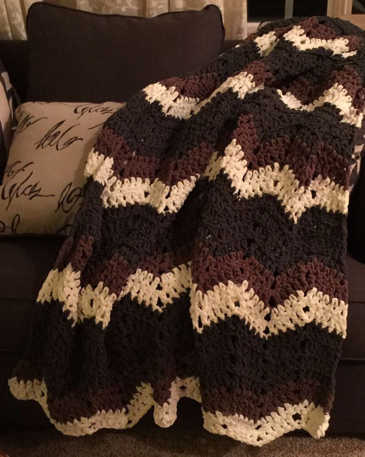 Super fast afghan using the Bernat Blanket yarn, a chevron pattern and a large 11.5 mm hook.   From BlueFrogCreek.com