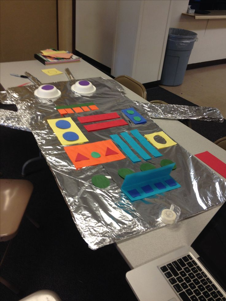 Robot Classroom Decoration Ideas : Robot made out of cardboard foil and construction paper