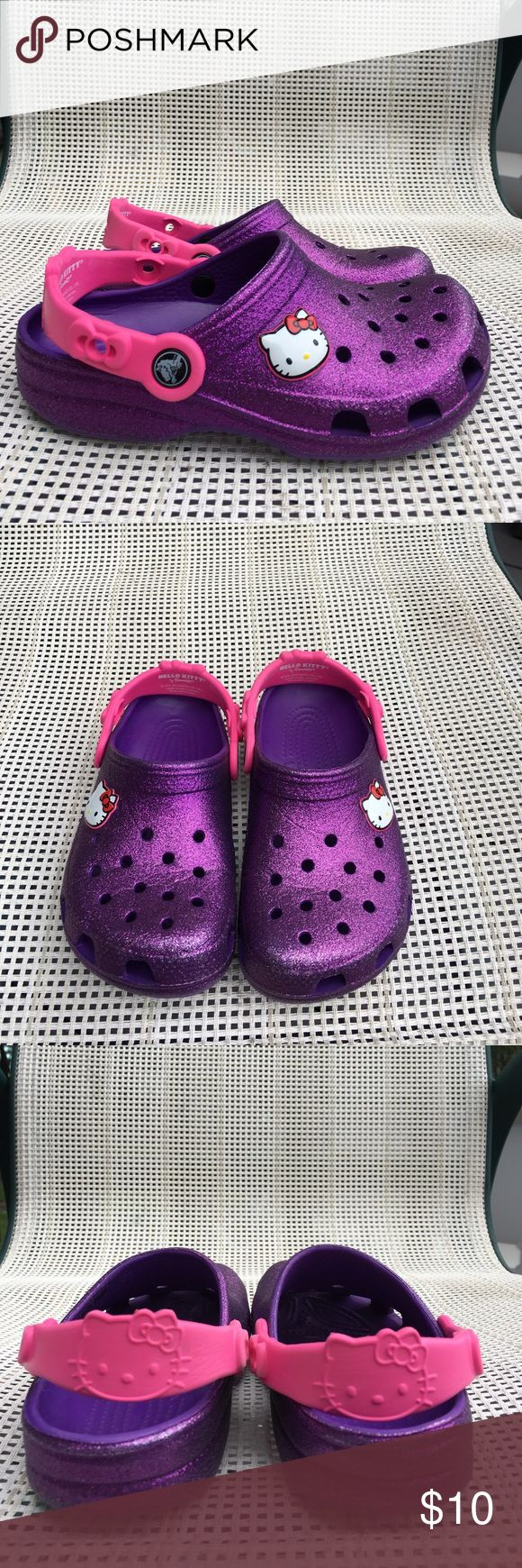 Crocs Hello Kitty metallic purple with pink strap Very nice crocs slip on shoes with Hello Kitty emblem on side. Very nice condition, no defects.EUC CROCS Shoes Sandals & Flip Flops