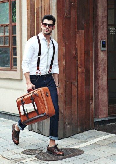 Shop this look on Lookastic:  http://lookastic.com/men/looks/long-sleeve-shirt-skinny-jeans-brogues-sunglasses-suspenders/11264  — Dark Brown Sunglasses  — White Long Sleeve Shirt  — Dark Brown Suspenders  — Navy Skinny Jeans  — Dark Brown Leather Brogues